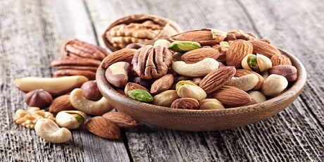 bigstock-nuts-mix-in-a-wooden-plate-112655147